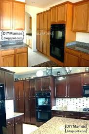 refinishing oak kitchen cabinets before and after cabinet restaining kitchen cabinets darker kitchen cabinets