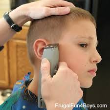 cutting boy hair with scissors how to do a boy s haircut with clippers