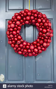 ornaments wreath hanging on outside of house door for stock