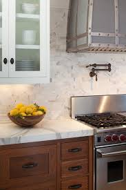 wood tone kitchen cabinets wood tone kitchen cabinets with marble or quartzite counter