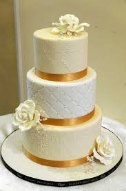 cake ribbon gold ribbon ivory flowers wedding cake on equally wed duet