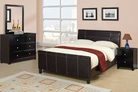 black leather bed frame with head board plus short black wooden