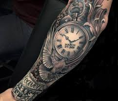 grey ink memorial clock and flying dove tattoo on full sleeve by