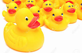 group of yellow rubber ducks next to each other surrounded by