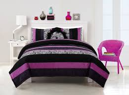 striped purple black and grey comforter sets on white wooden bed