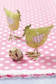 metal chicken ornaments and a quail s egg bild kaufen living4media