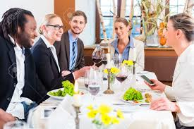 team at business lunch meeting in restaurant and