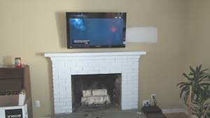 fireplace how to hang tv over fireplace amazing how to hang tv over fireplace home