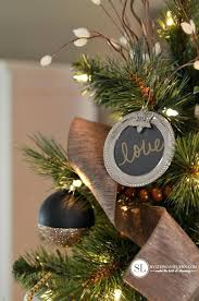 gold tree ornaments black and typography frame balls
