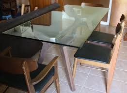 dining room chairs with leather seats transparent glass dining table on brown wooden base plus brown