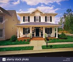 tiny two story house small two story white house with black shutters brick porch stock