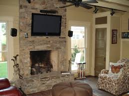 black fireplace with natural brown stone mantel completed wooden