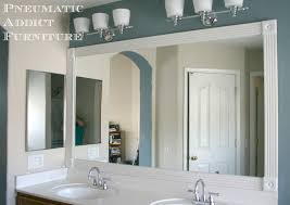 bathroom vanity makeover ideas added trim and rosettes to my builder grade mirror to spice things