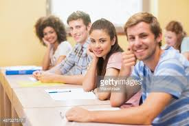 Picture Of Student Sitting At Desk Confident Students Sitting At Desk Stock Photo Getty Images