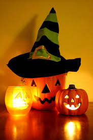 halloween jack o lantern bucket with witch hat and candles picture
