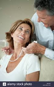 man pearl necklace images Mature man giving woman a pearl necklace stock photo 280495119 jpg