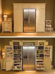 Kitchen Cupboard Interior Storage A Fridge Enveloping Pantry Cupboard Kitchens And Interiors