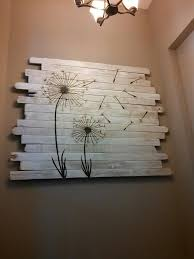 pallet wall with dandelions on whitewashed boards diy home