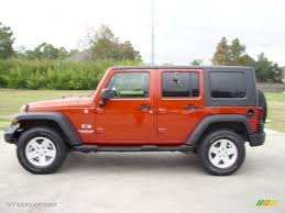 orange jeep rubicon 2009 sunburst orange pearl jeep wrangler unlimited x 4x4 40711133