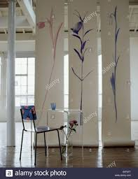 loft room dividers floral plastic chair and clear perspex table in loft conversion