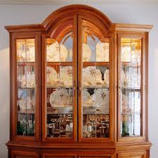 how to arrange a corner china cabinet pin on dining room