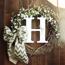 monogram wreath monogrammed grapevine wreath with white flower details intertwined