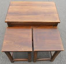 style nest of three oak coffee tables