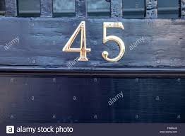 the number 45 on door plate of house in historic charleston south