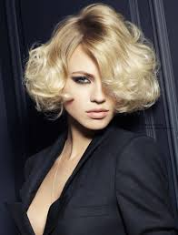 short and fluffy curly bob with a side part