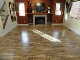 laminate hardwood flooring for enhancing your floor ideas amaza fascinating sleek laminate harwood flooring tile applied in contemporary living room furnished with fireplace completed with