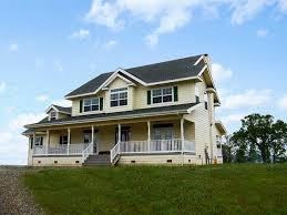 country farmhouse yellow country farmhouse farmhouse exterior other by lawson