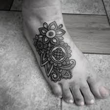 25 black and white flower foot tattoo