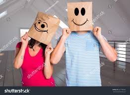young couple bags over heads against stock photo 251799583