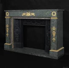 an empire style gilt bronze mounted green granite fireplace