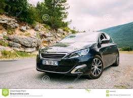 france peugeot black colour peugeot 308 car on background of french mountain