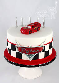 lightning mcqueen cakes for bottom part of cake with race track around bottom story
