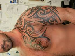 33 dramatic tribal tattoos for men for 2013