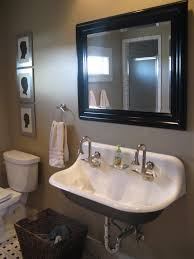 bathroom provides a transitional design perfect with trough sinks