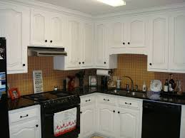 brown kitchen cabinets with white appliances u2014 smith design