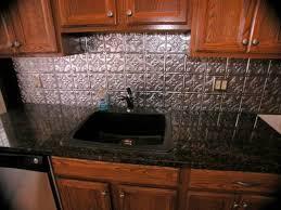 Backsplash For Black Granite by Black Granite Countertops With Tin Look Backsplash Ontario