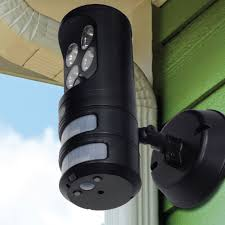 motion light security camera the motion tracking security light hammacher schlemmer