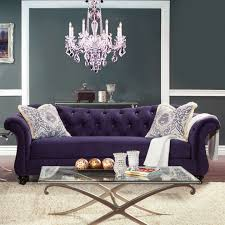 formal living room furniture with purple sofa and chandelier