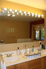 new installing bathroom light fixture over mirror interior design