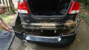 how to remove and install chevy aveo rear bumper cover part 2