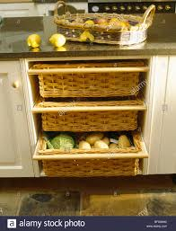 close up of kitchen storage baskets in cream fitted unit with