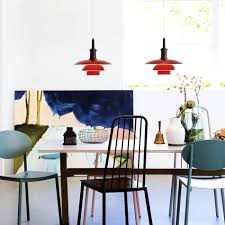 hanging light fixtures over dining table with room lighting