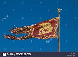 Lion Flag Golden Lion On The Dark Red Flag Of Venice Against A Deep Blue Sky