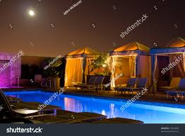 cabana and swimming pool at night stock photo 13541836 shutterstock