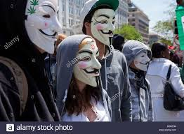 Guy Fawkes Mask Halloween by A Group Of People Wearing Guy Fawkes Masks At A Rally Stock Photo