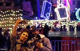 festival of lights riverside 2017 riverside dec 11 2017 people take selfies during the 25th